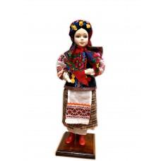 """Лялька керамічна сувенірна у народному вбранні """"Українка"""" на підставці ручна робота."""